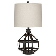 $174 Illuminate your master suite bedside or favorite reading nook in industrial-chic style with this eye-catching table lamp, showcasing an open fretwork metal b...  Antiqued bronze and beige