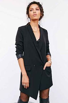 I bought this jacket, but have never worn it.  I'm puzzled what to pair it with.  I can't show off that much leg at work.