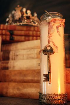 Love the religious candle with the key and gold ribbon/old books