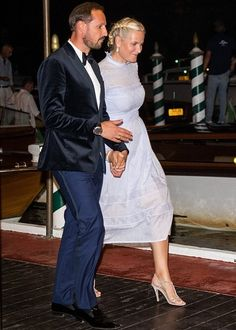 Crown Princess Mette-Marit of Norway and Crown Prince Haakon of Norway attended the 73rd Venice Film Festival on September 2, 2016 in Venice, Italy. At the Film Festival, Crown Princess Mette Marit wore Vilshenko Lavender Midi Dress.