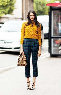 Love how this girl breaks up a leopard coat and plaid pants with a chunky mustard sweater