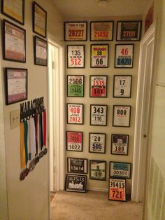 Someday I want to have enough racing bibs and finisher medals to do this in my house!