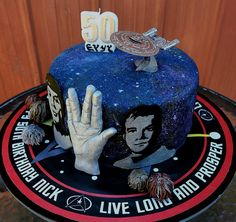 Star Trek themed cake with Galaxy background, complete with Captain Kirk, Spock, the Vulcan Salute, Starship Enterprise, the Tribbles, Balok and the birthday boy's name in Klingon.  Live Long and Prosper!  Inside: Rich moist chocolate cake with whipped dark chocolate ganache.
