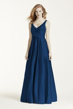 A modern approach to a classic silhouette, your bridesmaids will look elegant in this exquisite gown!  Strapless ruched bodice with ultra-feminine v-neckline  Long full skirt features trendy side pockets  Fully lined. Back zip. Imported. Dry clean only.  Also available in Extra Length as Style 4XLF15741.