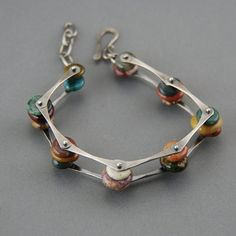 Similar to my Pinned Pebbles Bracelet, but with more stones! Ocean Jasper pebbles are linked together between bars of forged sterling silver. They are