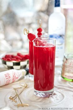 red raspberry rascal cocktail | 12 ounces Frozen Raspberries  1/4 cup Water  4 ounces Vodka  8 ounces Soda Water  Stevia Drops or your favorite sweetener  splash of Rhubarb Bitters  Fresh Raspberries (for garnish)  Ice