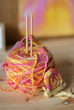 Pretty yarn and a snail made from spool knitting