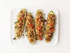 Get this all-star, easy-to-follow Herb-Stuffed Zucchini recipe from Food Network Magazine.