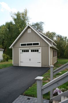 This Elite Garage Features A Mini Shed Dormer Look At How The Transom Windows Above