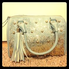 SALE Light blue sparkle purse Light blue sparkle purse. So pretty!!!! Great condition on the outside. Had a little bit of staining on the inside. Charming Charlie Bags