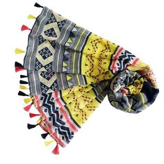 This is a great scarf to see you through spring & summer! It's bright and beautiful and covered in an aztec print with navy, pink & yellow tassels on each end. A great casual scarf for all ages making it a great gift for a friend...or yourself!  It's super soft and large enough to wear as a wrap and also makes a great sarong. It's a generous size but lightweight and very comfortable.  All scarves come wrapped in pretty pink tissue finished with an Annie's Closet label.