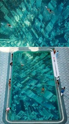 Pool with a bottom designed to make it look like a city underwater, Wow!
