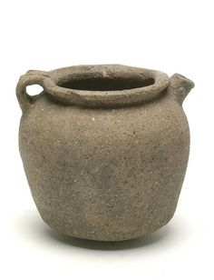 Back to Saxon (AD 450 - 1066)             Title:  Late Saxon shelly ware pitcher    Description:  Late Saxon shelly ware with a spouted pitcher, with convex base and an everted rim and strap handle.