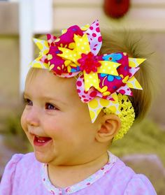yellow hair bow...lovely baby hairbow ...a great headband forinfants, toddlers, and big girls...yellow and pink baby bow...infant head band. $8.99, via Etsy.