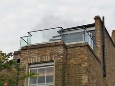 Frameless Glass Balustrade On Parapet Wall With Lots Of Corners | Glass Balustrades, Juliet Balconies & Balcony Railings Manufacturer