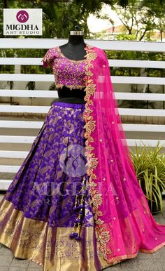 Fuchsia pink paired up with dark Violet pattu lehenga to get the vibrant effect and bold golden pasley and florals embroidered all over work. Now available on MugdhaArtStudioFor Order (or) EnquiryWhats app 8142029190 / 9010906544 21 September 2018 Lehenga Saree Design, Half Saree Lehenga, Lehenga Gown, Lehnga Dress, Lehenga Designs, Anarkali, Banarasi Lehenga, Bollywood Lehenga, Pink Lehenga