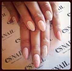 I really love this, especially the nude color and almond/rounded nails. Oh! And the crosses #yes