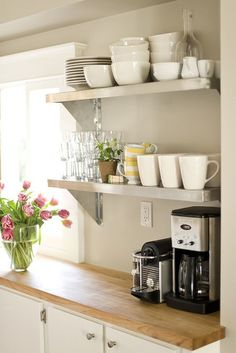 So pretty! I love these counters and the   open shelves for dishes!