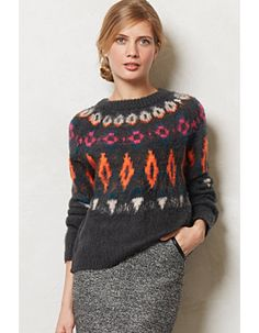 We have this fabulous Numph sweater...the pops of color are a perfect way to break up all the black you might be wearing :)