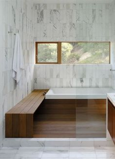 Teak bench and tub flange in shower for home spa
