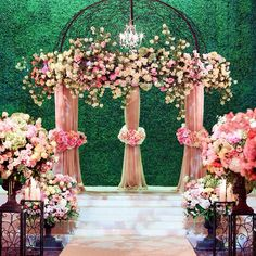 Lush and lavish floral for a breathtaking ceremony space. The green backdrop is everything!!