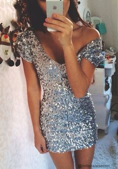 Don this glimmering silver sequined dress for a look that will turn heads.
