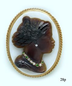 """Carved agate """"blackamoor"""" cameo   (herself set with diamond and emerald jewels)  and gold brooch"""