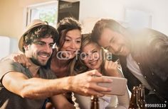 """Laden Sie das lizenzfreie Foto """"Friends taking selfies on a smartphone in a charming house. """" von jackfrog zum günstigen Preis auf Fotolia.com herunter. Stöbern Sie in unserer Bilddatenbank und finden Sie schnell das perfekte Stockfoto für Ihr Marketing-Projekt!"""