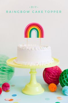Make this adorable rainbow cake topper.  It is soooo simple to make and perfect for any rainbow or unicorn themed parties!  -DIY- Craft Blog- Tell Love and Party