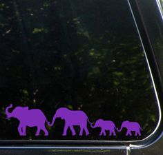 """- Cute family of Elephants walking in a line holding trunks to tails. - Add Extra Babies with the Extra Babies 3-Pack - decals can be cut apart before application to arrange as desired. - Approx Size As Shown: 8.5""""w x 2""""h - Yadda-Yadda Design Co. Brand decal. Manufactured in the USA by Yadda-Yadda Design Co. - High Quality Outdoor Rated 6 Year Glossy Vinyl - Instructions and 2 practice decals included with every order. - Manufactured and sold exclusively by Yadda-Yadda Design Co.TM This is a…"""