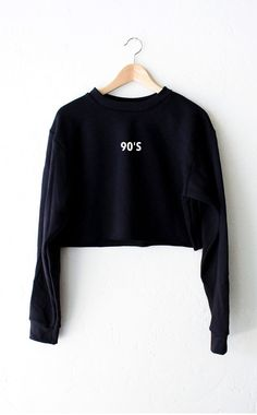 "- Description Details: Oversized, loose fit cropped sweater in black with print featuring '90s' on front center. Brand: NYCT Clothing. Measurements (Size Guide): XS/S: 40"" bust, 17.5"" length, 25"" slee"