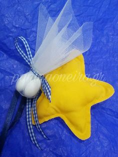 Handmade Christenning or babyshower star favor made of cotton fabric and ribbon!