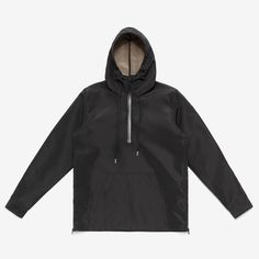 Black pullover raincoat with high collar drawstring hood and font pouch pocket, made with water resistant bonded Japanese fabric. Side seam vents with mesh gussets and waterproof zippers. Waterproof p