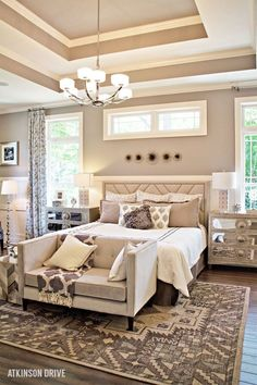 Dreaming of a luxurious master bedroom? Create your own relaxing retreat with a few furniture staples: a stately bed, stunning side tables, a chic bench at the foot of the bed, a dazzling area rug, and beautiful décor accents.