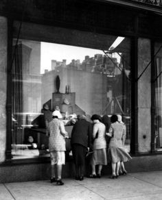 Vintage Saks. Window shoppers at Saks Fifth Avenue, New York City, 1924.