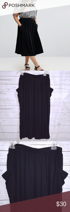 """ASOS CURVE Black Midi Skirt with Pockets ASOS CURVE Women's Midi Skirt Pockets Black Jersey Knit Stretch Plus Size 20 NWT Brand New only taken out of packaging for pictures.  Measurements: Waist 39"""" (Elastic Stretch Waist) Length 32"""" Condition: New with Tags ASOS Curve Skirts Midi"""