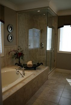 Master Bathroom...l love the extra space beside the tub and the clear shower..