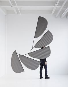 Design duo GamFratesi has installed petal-shaped mobiles above the lounge area at this year's Stockholm Furniture Fair 2014.