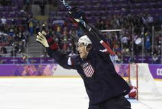 USA forward T.J. Oshie (74) reacts after scoring a goal past Russia goalkeeper Sergei Bobrovski (72) in the overtime shootout in a men's preliminary round Ice Hockey game during the 2014 Olympic Winter Games at Bolshoy Ice Dome. #TeamUSA
