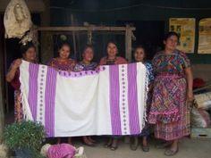 MayaWorks' artisans proudly displaying their handmade Lavendar Tallit!