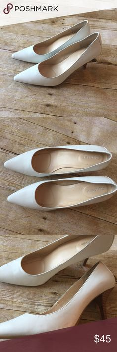Calvin Klein White Dolly Pumps Great condition! Tiny mark where I sticker was on side (pictured) but could probably be removed super easy with the right remover :) Still nice as is though! Calvin Klein Shoes Heels