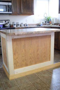 Add Molding to a Builder Grade Kitchen Island: An Easy How-To - Love Remodeled - Add Moulding to a Kitchen Island: An Easy How-To – Love Remodeled Best Picture For small kitchen - Kitchen Island Molding, Kitchen Island Makeover, Diy Kitchen Island, Kitchen Redo, New Kitchen, Kitchen Cabinets, Kitchen Ideas, Kitchen Island Remodel Ideas, Kitchen Counters