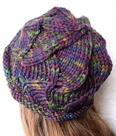 Knitting Pattern for Swirl Hat - Swirls of waves are shaped with decreases in this slouchy beanie knit in bulky yarn. Great with multi-colored yarn