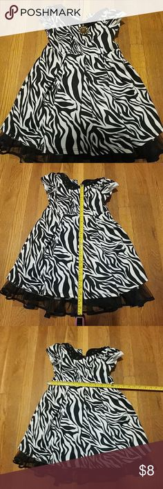 Girl's size 5 zebra patterned dress Girl's size 5 zebra patterned dress Has tulle beneath Fully lined This has been previously loved but still has life in it for another young lady!  30% off a bundle of three or more items Everything is negotiable Smoke free home Pet free home All items deserve a 2nd chance at happiness Currently not trading Youngland Dresses Casual