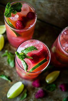 Raspberry Mojitos   HeatherChristo.com #cocktails #mojitos #drinks
