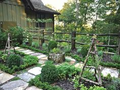 Step out into this picturesque petite kitchen garden and find all the herbs you need for the evening's feast. A rustic wood fence guards the perimeter.