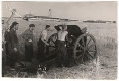 Spain - 1937. - GC - Republican soldiers with artillery, Brunete, July 1937//Gerda Taro