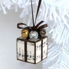 Small Sheet Music and Jingle Bells Decorated Ornaments: Decoupaged a tiny cube wood block with sheet music and finished with jingle bells. It is then to be this cutest ornaments for rustic Christmas decoration or used as gifts. - My Wood Crafting Rustic Christmas Ornaments, Noel Christmas, Ornaments Ideas, Simple Christmas, Musical Christmas Decorations, Xmas Decorations To Make, Amazon Christmas, Handmade Christmas Decorations, Hallmark Christmas