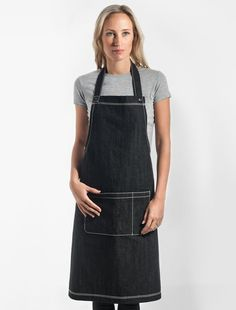 Our signature Harvest Bib Apron in Black Denim is made of high quality denim, making it the ideal uniform piece for hospitality staff. Finished with contrasting white stitching and Cargo Crew gold stud, this apron is the perfect balance of style and practicality. The Harvest is made from durable denim that offers premium quality. The denim fades with age and grows in character, just like your favourite pair of jeans. Also available in Indigo Denim, and as a mini bib, and short waist apron…