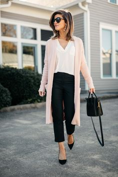 pink cardigan, white lush tunic, and black pants